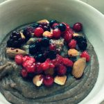 Chocolate pudding with red fruits and almonds