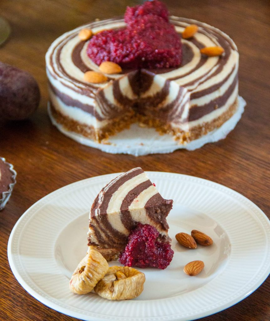 Sugar free zebra cake with one piece of cake with almonds and figs