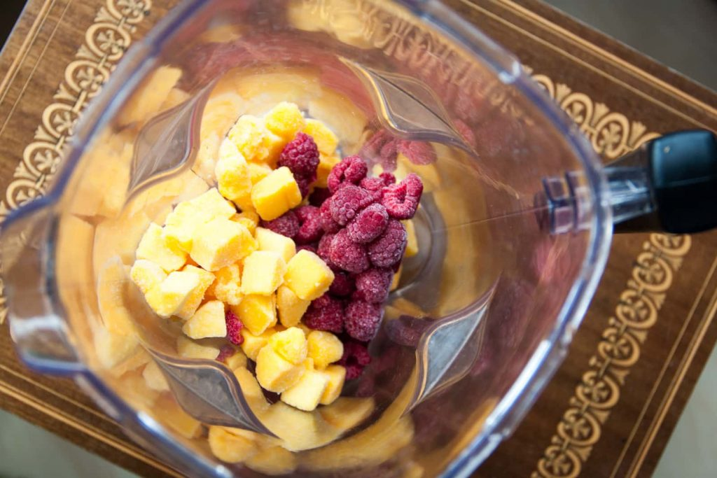 Frozen mango and raspberry in Froothie's Optimum G2.1 Platinum series blender