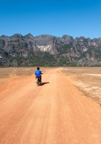 Thakhek Loop: dirt road and local on a scooter