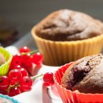 A close up of blueberry banana muffins with redcurrants