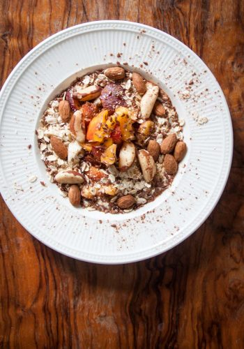 Oats with yoghurt, fruit and nuts on a table