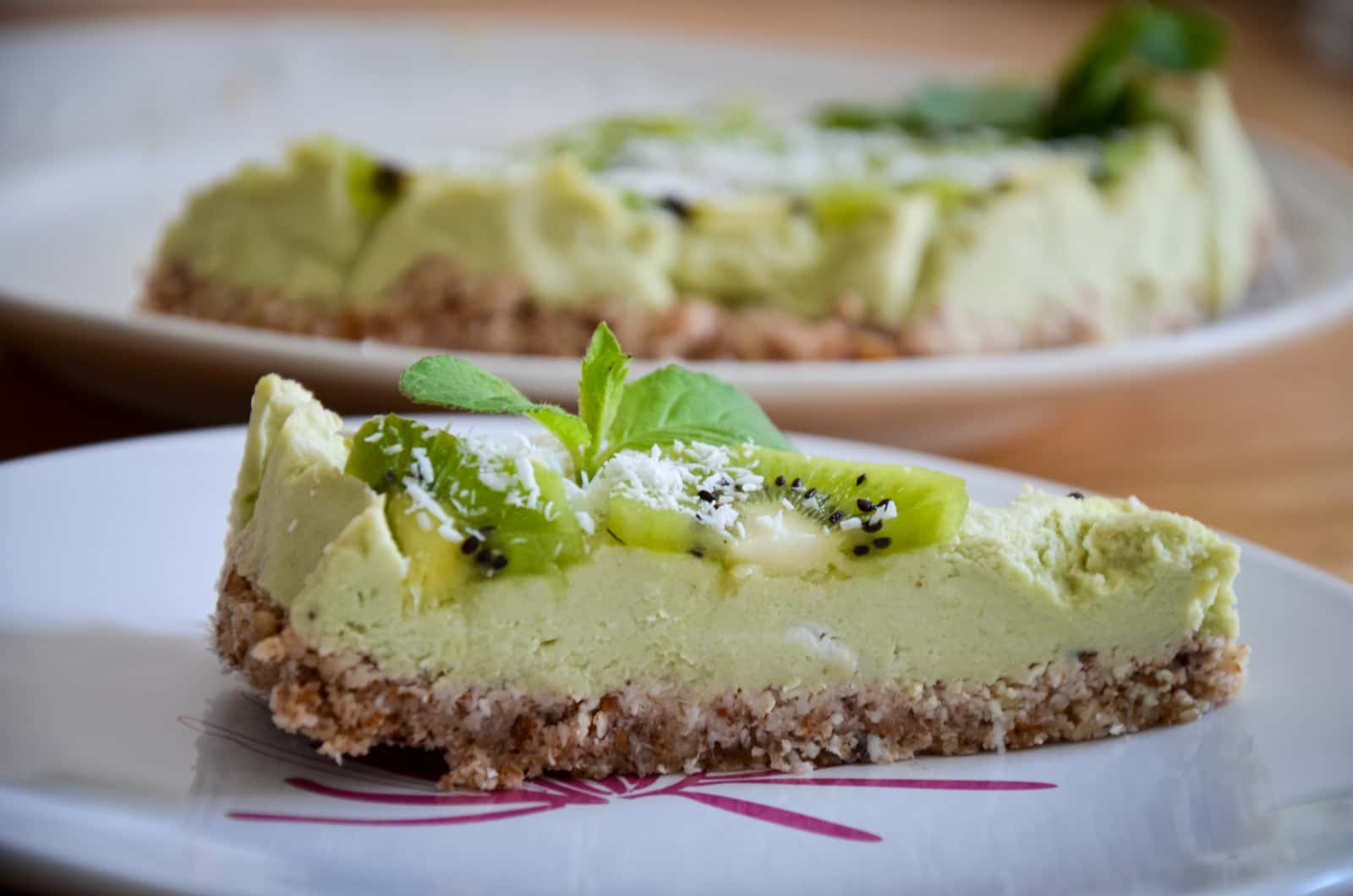 Piece of raw avocado lemon cake with kiwi